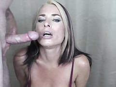 Hot whore on her knees gets her mouth and face covered in jizm