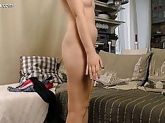 Cute red-haired nubile strips nude and fingers her vagina