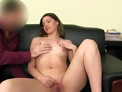 Scorching stunner disrobes naked and thumbs her smooth-shaven beaver slot